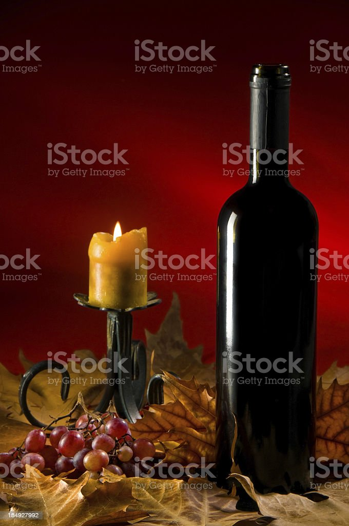 Bottle of Red Wine and Candle royalty-free stock photo