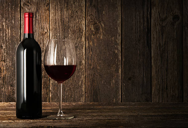 Bottle of red wine and glass stock photo