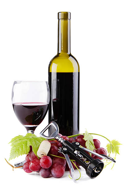 Bottle of red wine with grapes stock photo