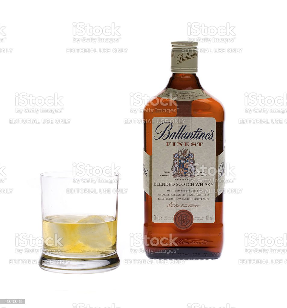 Bottle of scotch whiskey Ballantine's and a glass stock photo