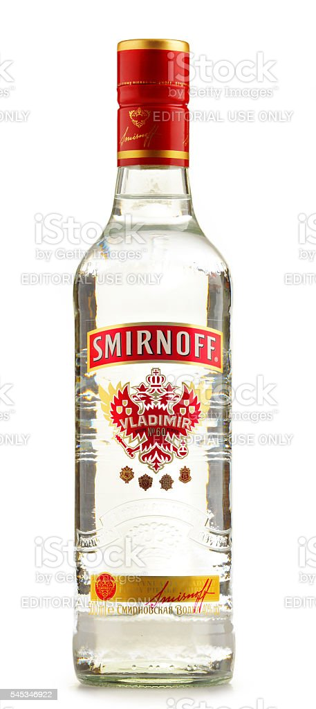 Bottle of Smirnoff Red Label vodka isolated on white stock photo
