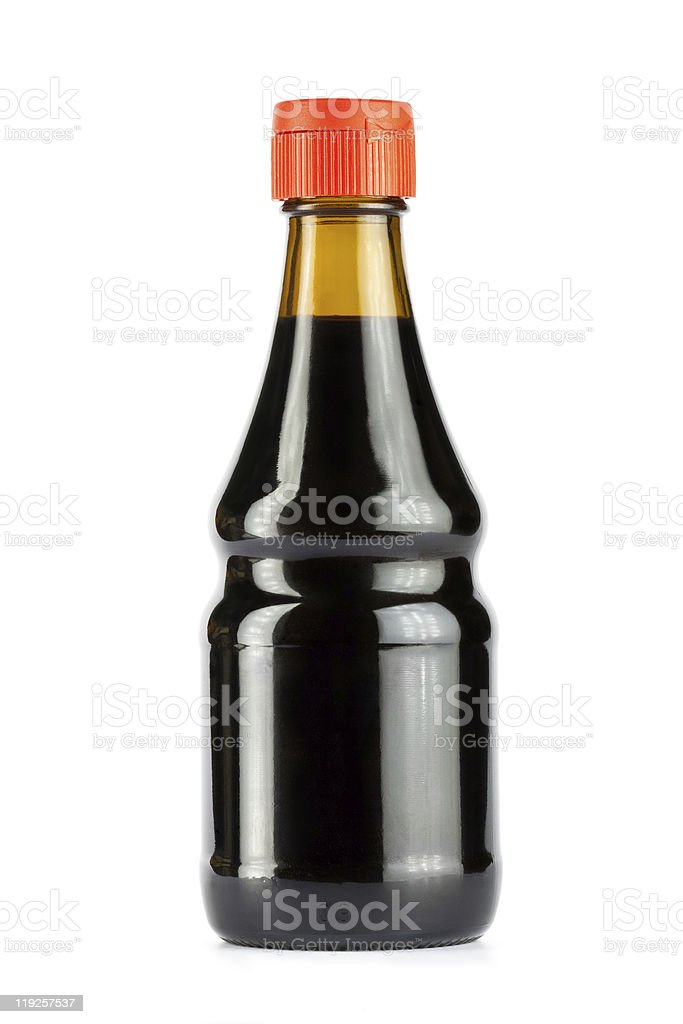 A bottle of soy sauce with orange screw on lid and no label stock photo