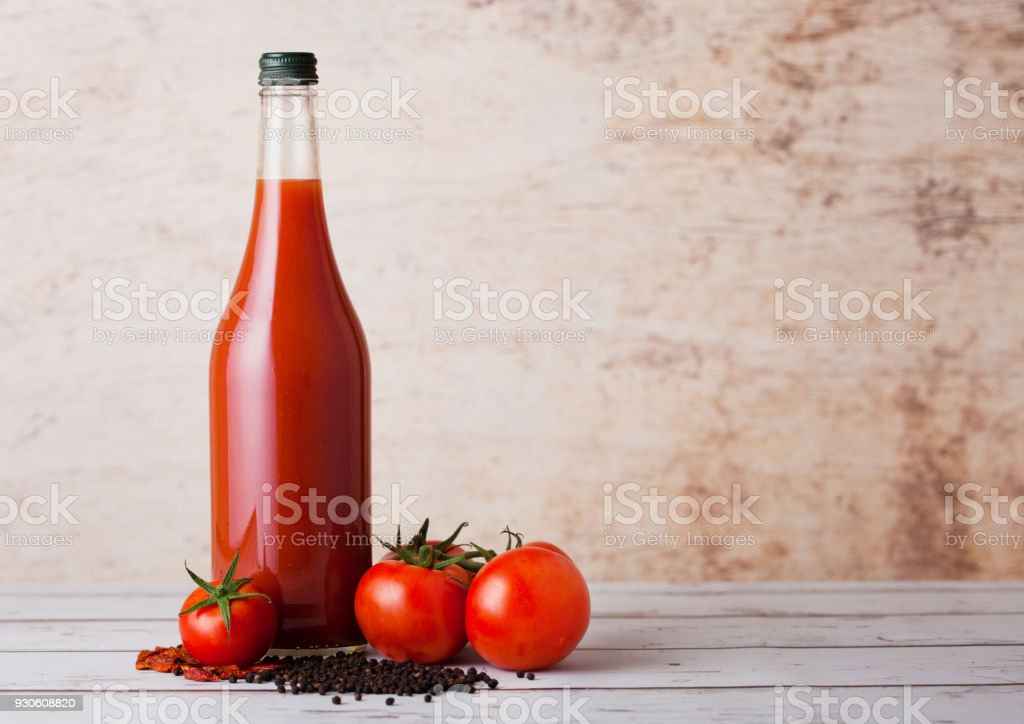 Bottle of spicy tomato juice with black pepper