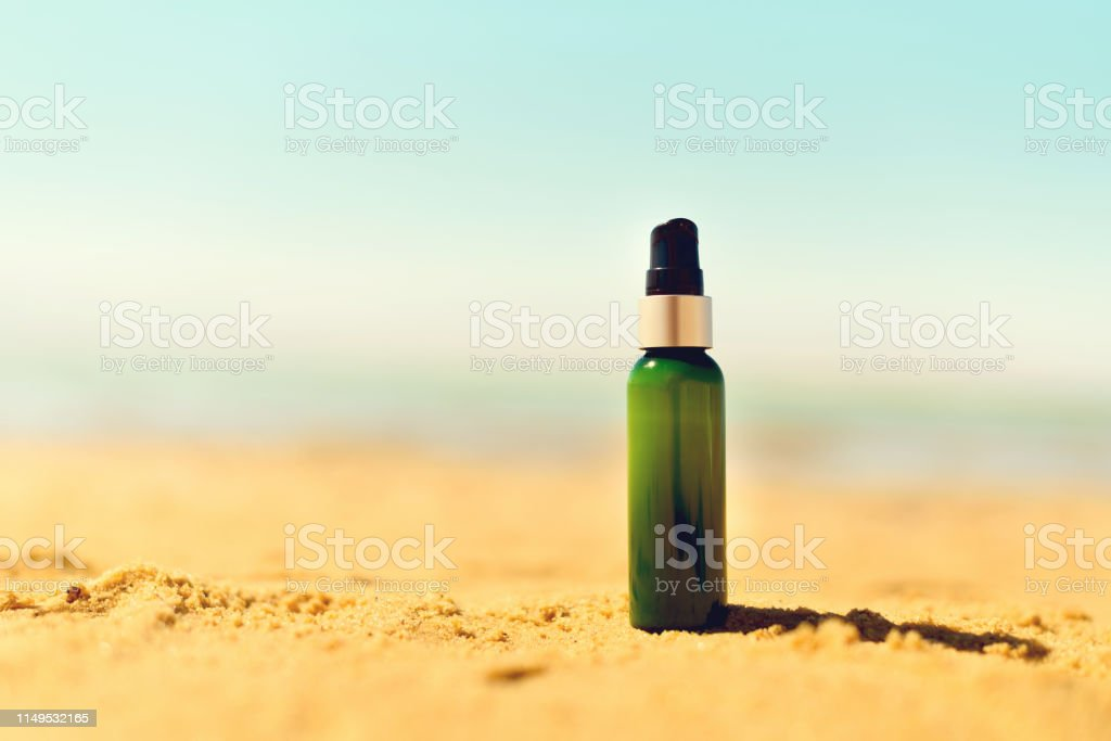 Bottle Of Sunscreen In Sand Against Sea Background With Copyspace Vacation And Travel Wallpaper Skin Care Concept Stock Photo Download Image Now Istock