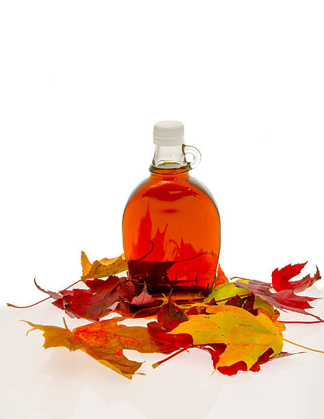 bottle of syrup - maple syrup stock photos and pictures