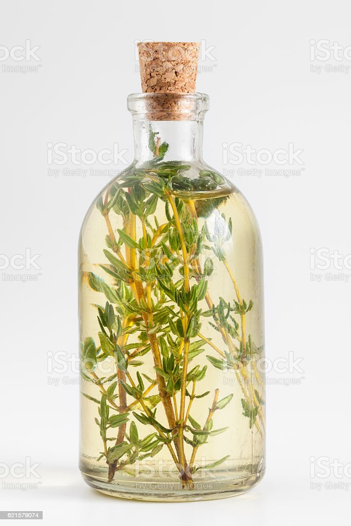 Bottle of thyme essential oil or infusion stock photo
