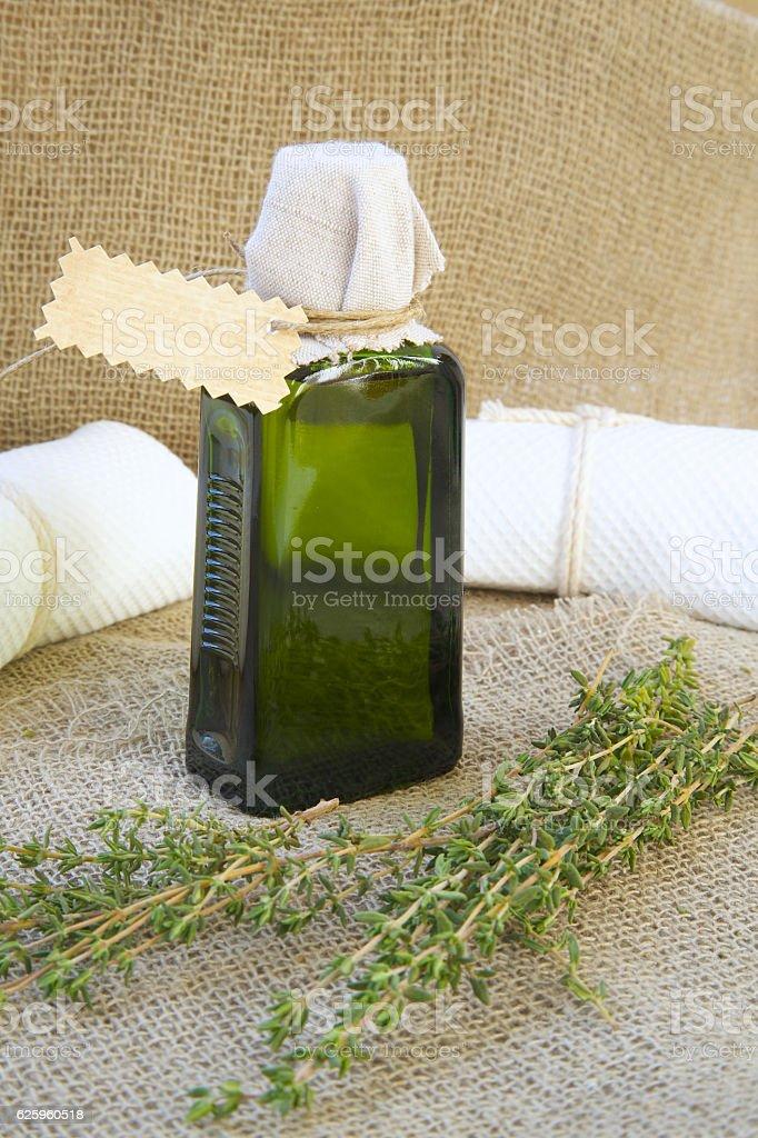Bottle of thyme oil stock photo