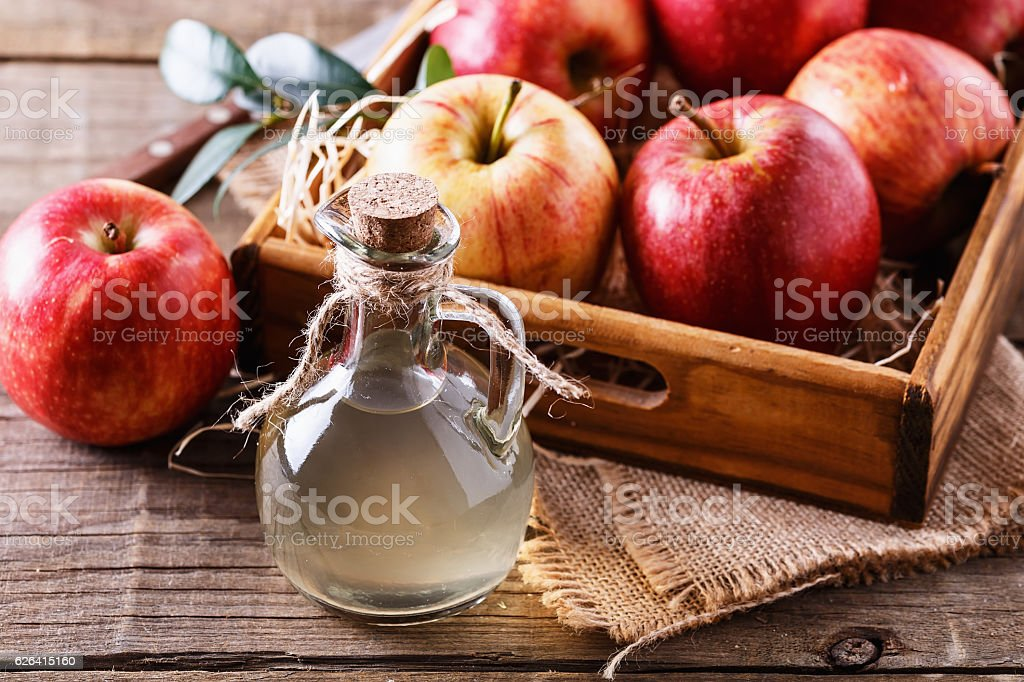 Bottle of unfiltered apple cider vinegar stock photo