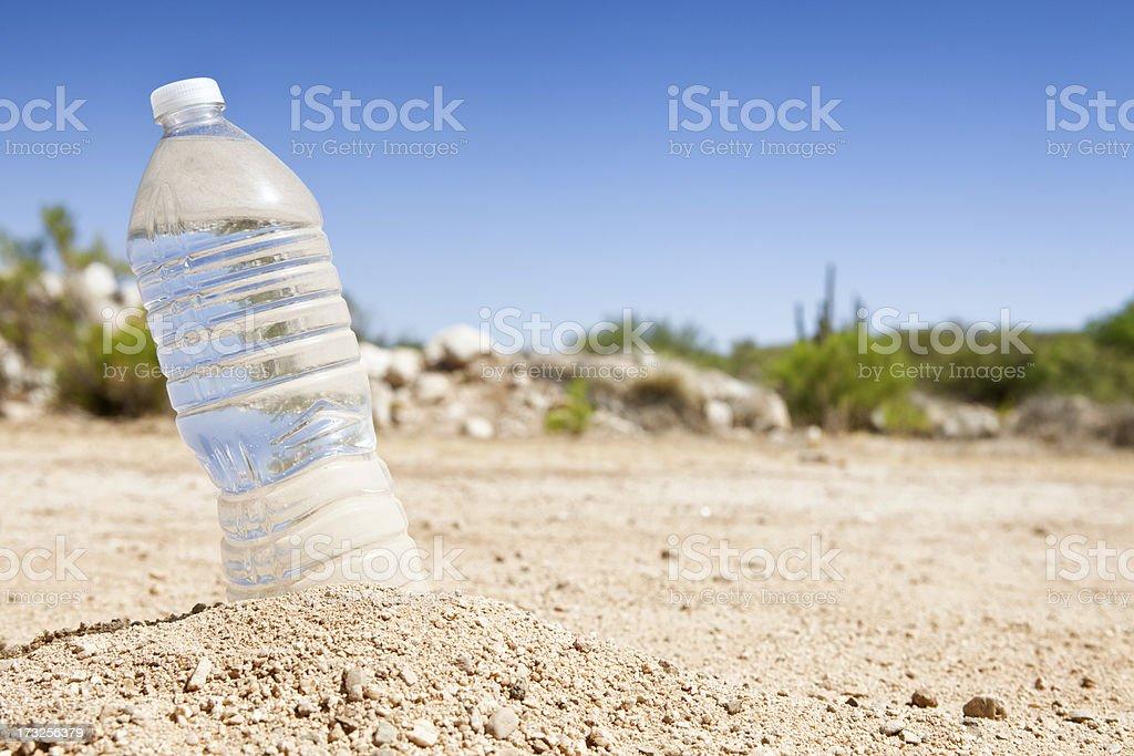 Bottle of Water in the Desert stock photo