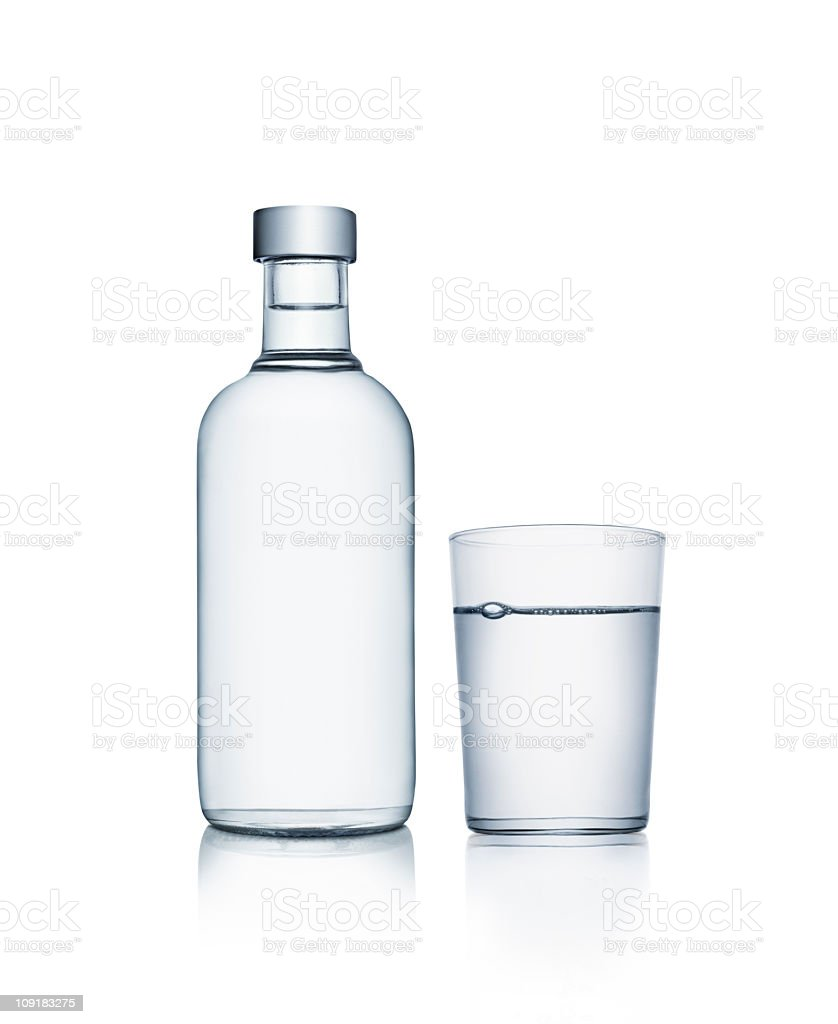Bottle of water with glass royalty-free stock photo