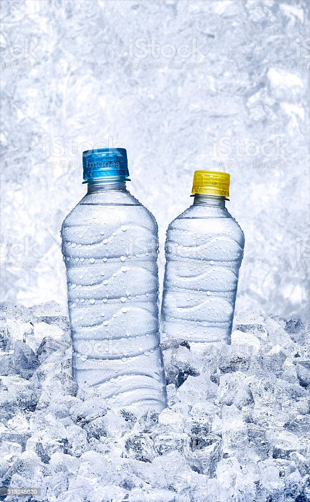 bottle of water with ice stock photo