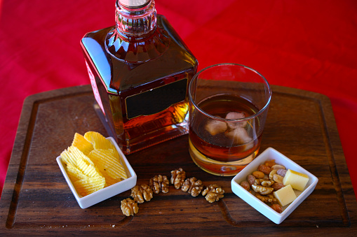 bottle of whisky and cup with cookies