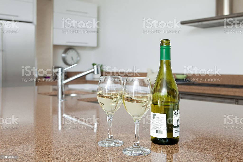 Bottle of white wine and wine glasses royalty-free stock photo