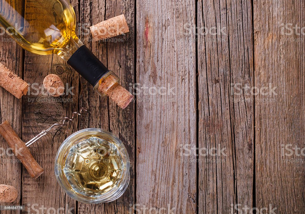 Bottle of white wine, grape  on wooden table stock photo