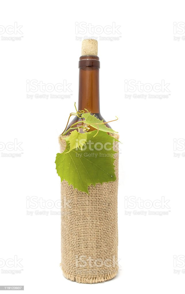 Bottle of White Wine in Sackcloth royalty-free stock photo