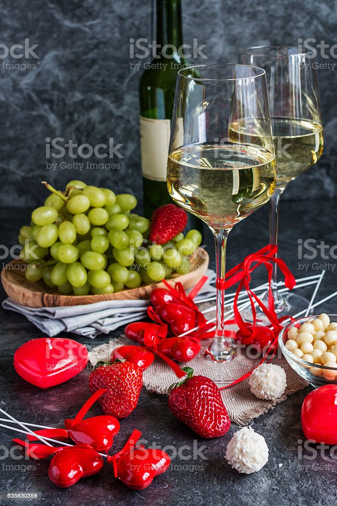 Bottle of white wine, two glasses and grapes bunch stock photo