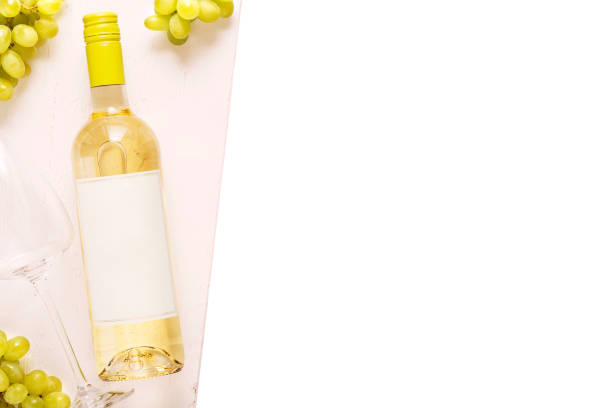 Bottle of white wine with label. Glass of wine and cork. Wine bottle mockup. isolated on a white background. Top view. stock photo