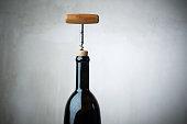 Corkscrew and wine bottle, opening a bottle of wine in celebration