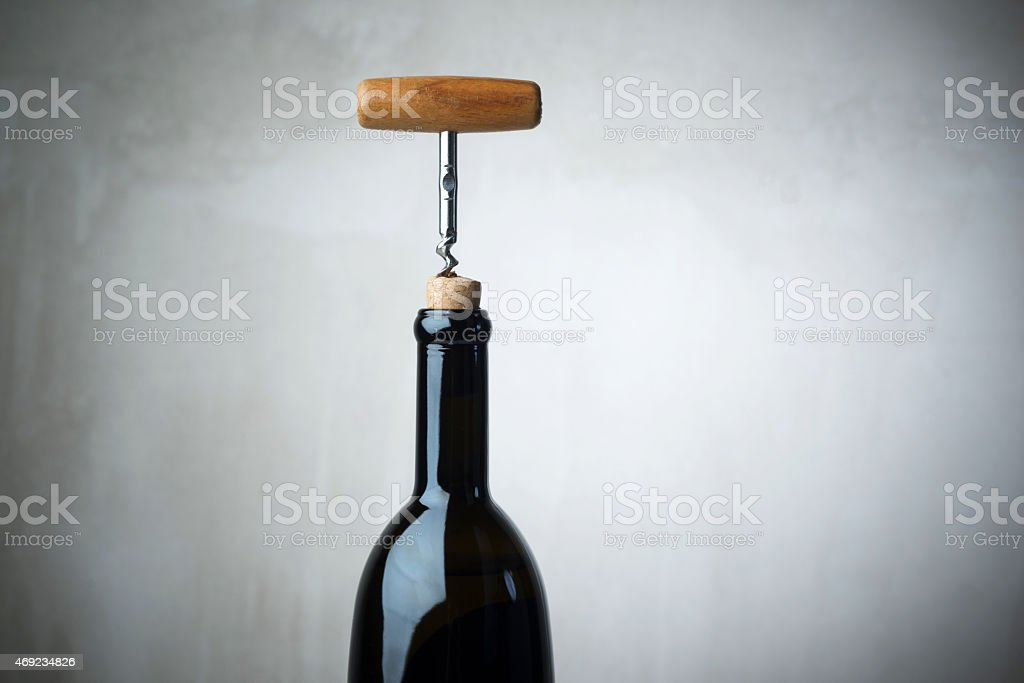 Bottle of wine and corkscrew stock photo