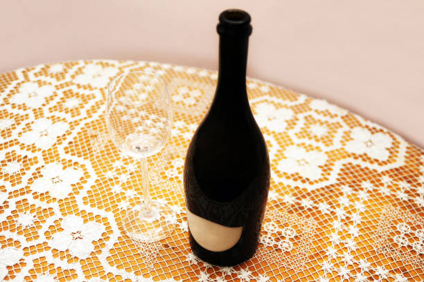 Bottle of wine and glass on table stock photo