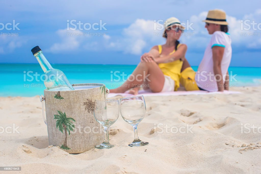 Bottle of wine and two glasses background happy couple stock photo