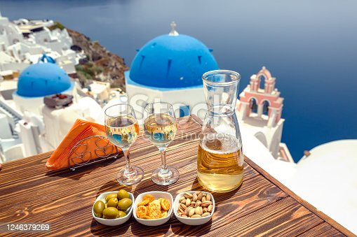 istock Bottle of wine and two glasses on Santorini 1246379269