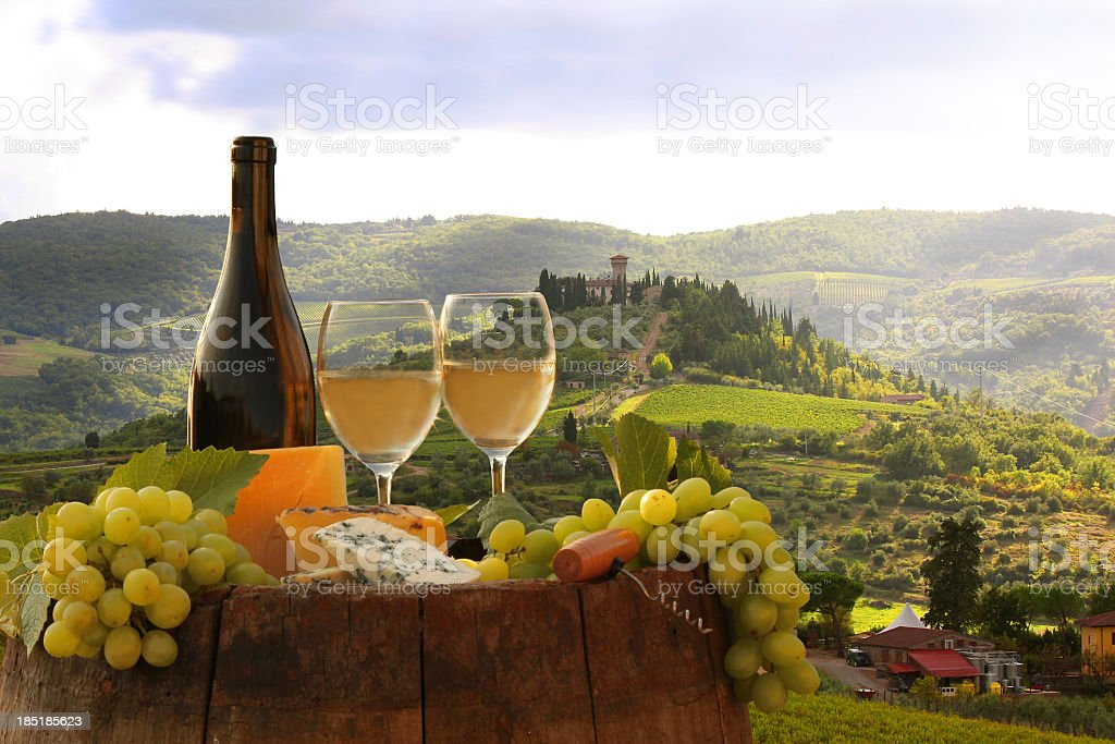 Bottle of wine, cheese and grapes overlooking Chianti view stock photo