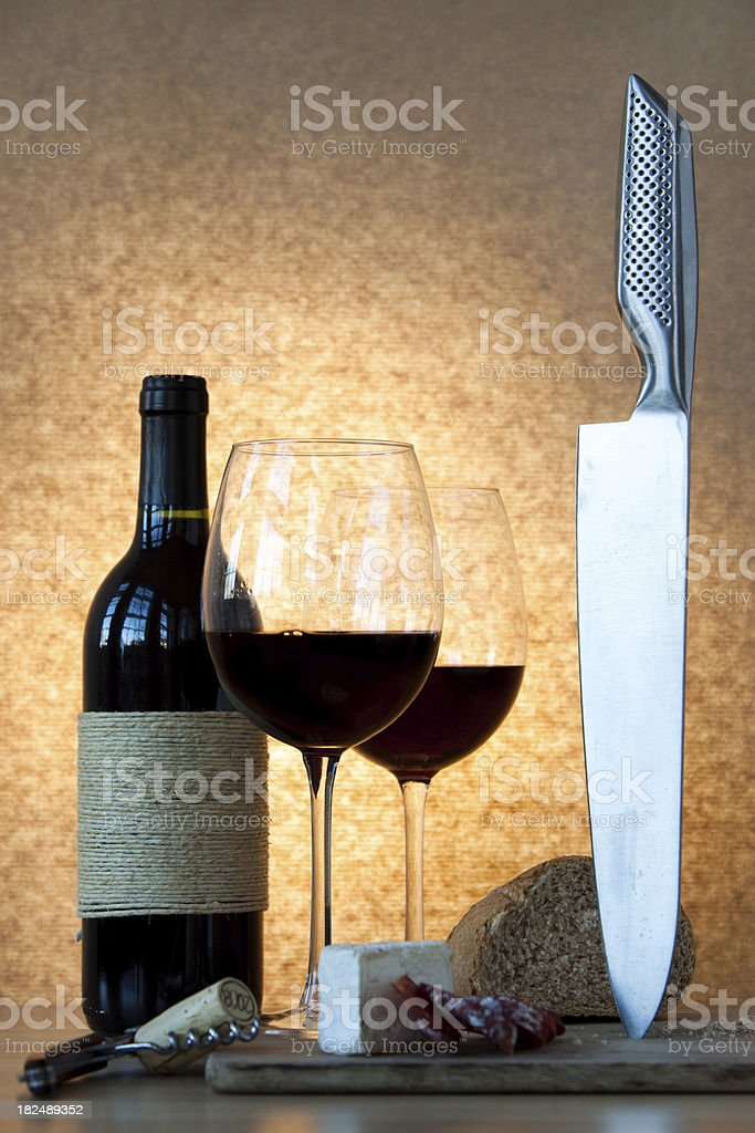Bottle of wine, glasses, salami and bread. royalty-free stock photo