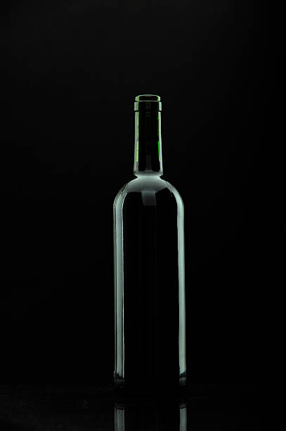 bottle of wine over black, reflexions. stock photo