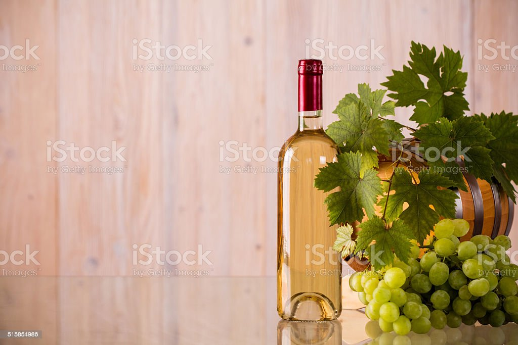 Bottle of wine with a barrel stock photo