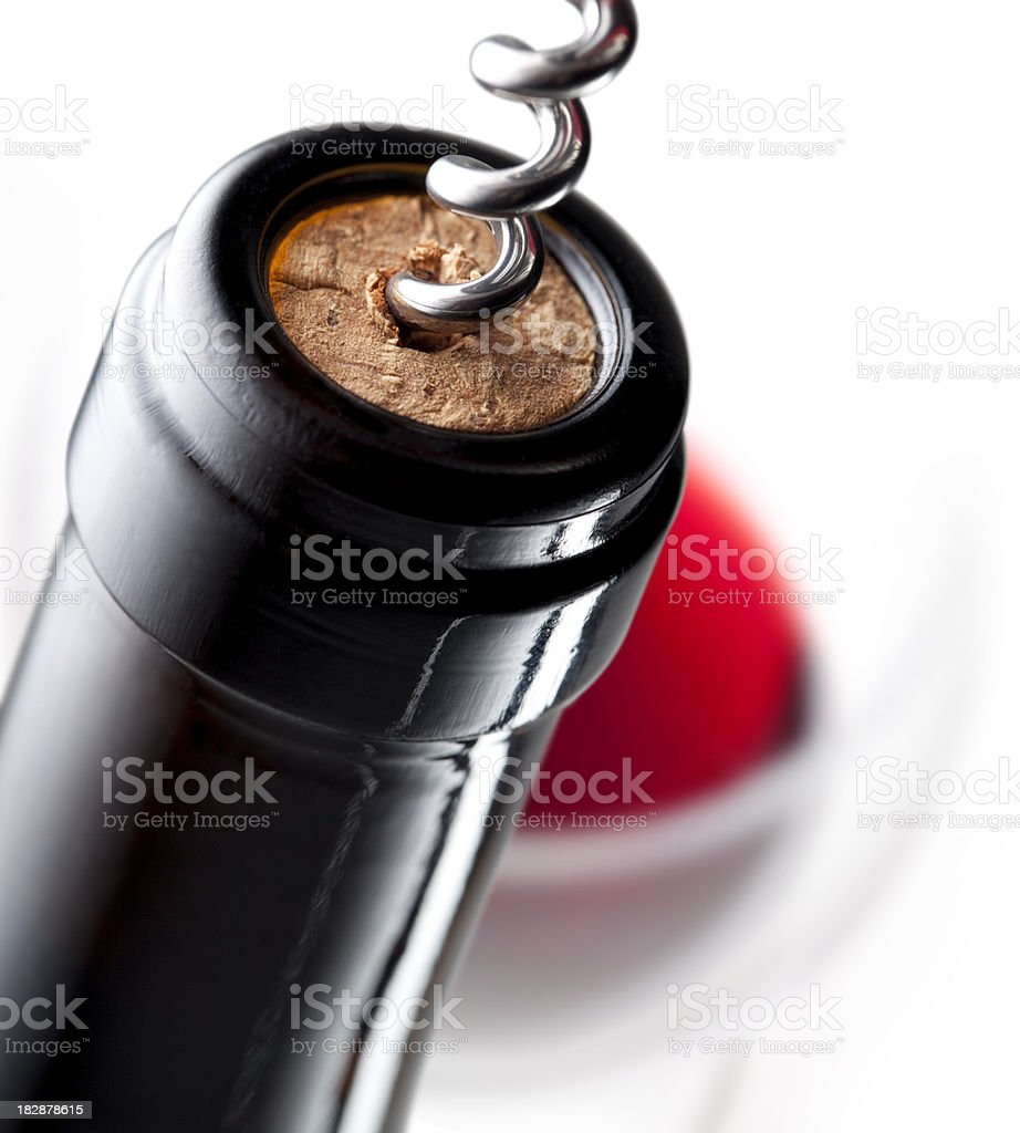 Bottle of wine with a corkscrew royalty-free stock photo