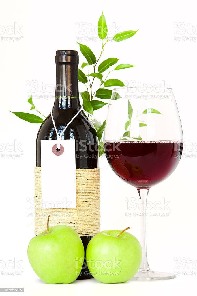 Bottle of wine with full glass, apples and plant royalty-free stock photo