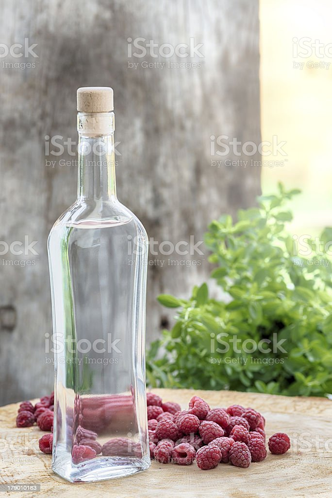 Bottle Raspberry Fruit Brandy  Himbeerschnaps Obstler royalty-free stock photo
