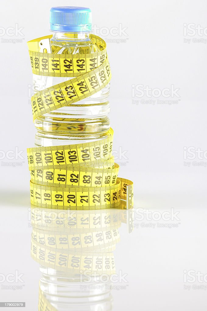 bottle surrounded by measurement royalty-free stock photo