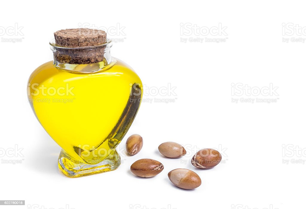 Bottle with argan oil. Cosmetic means. Food product. Isolated background. - foto de acervo