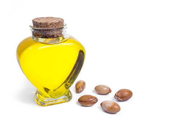 Bottle with argan oil. Cosmetic means. Food product. Isolated background. stok fotoğrafı