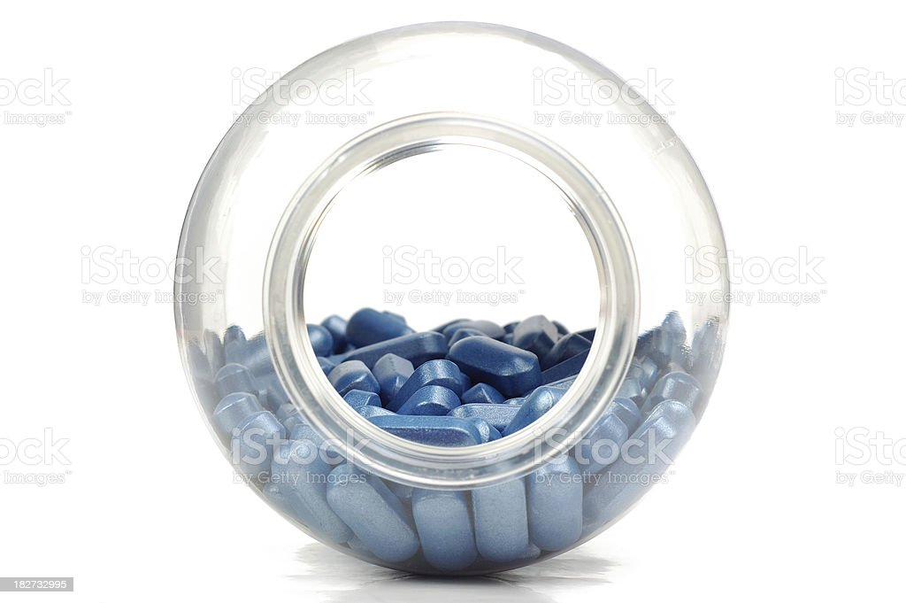 Bottle with blue tablets royalty-free stock photo