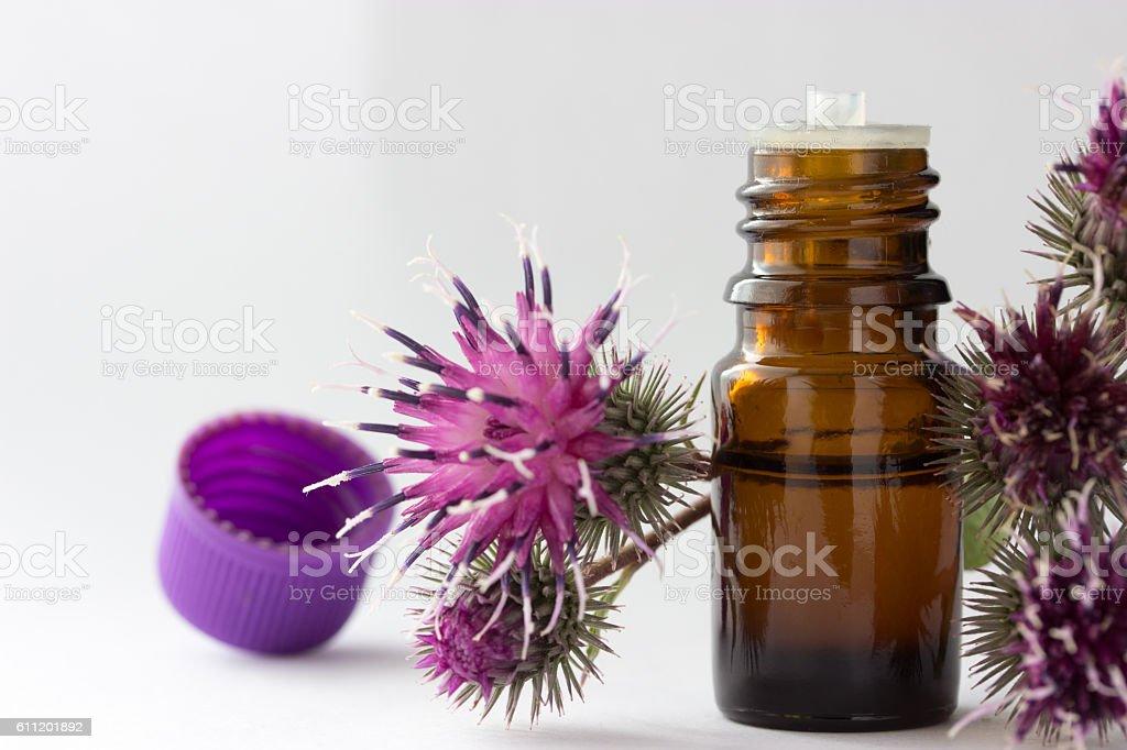 bottle with burdock oil - foto stock