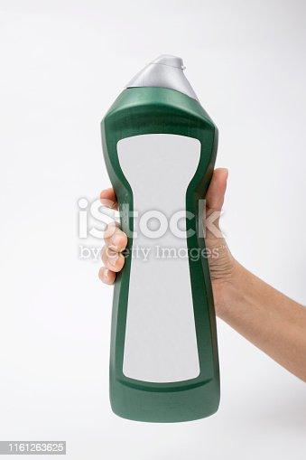 istock Bottle with detergent in hand 1161263625