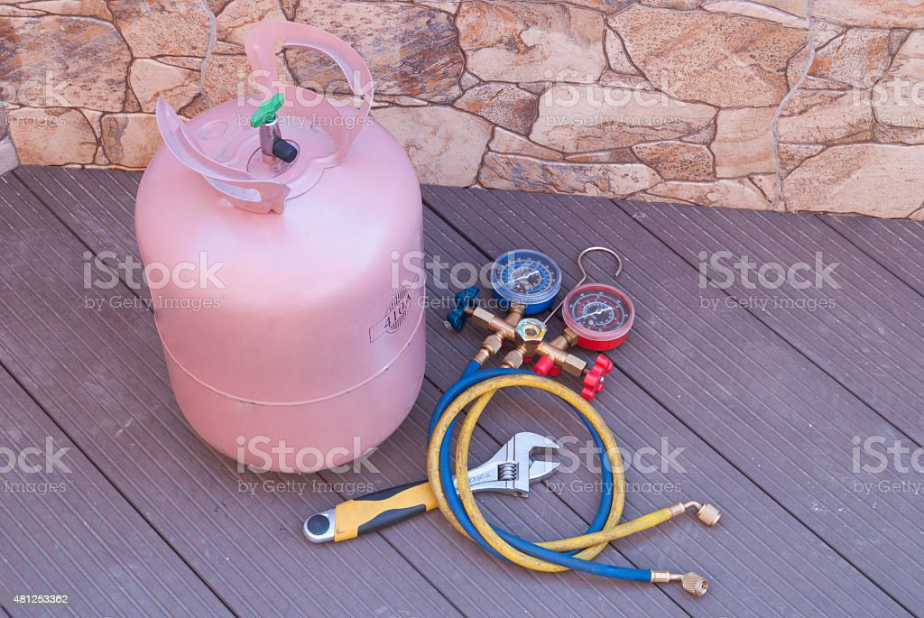 bottle with freon bottle with Freon and tools for refueling of air conditioners 2015 Stock Photo