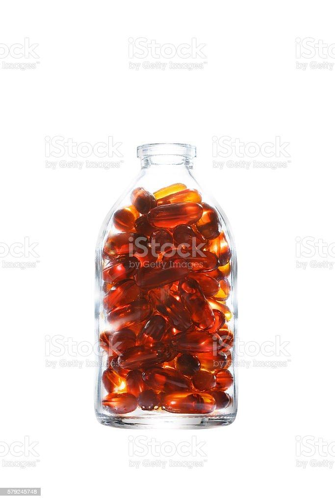 Bottle with gelatin capsules on white stock photo
