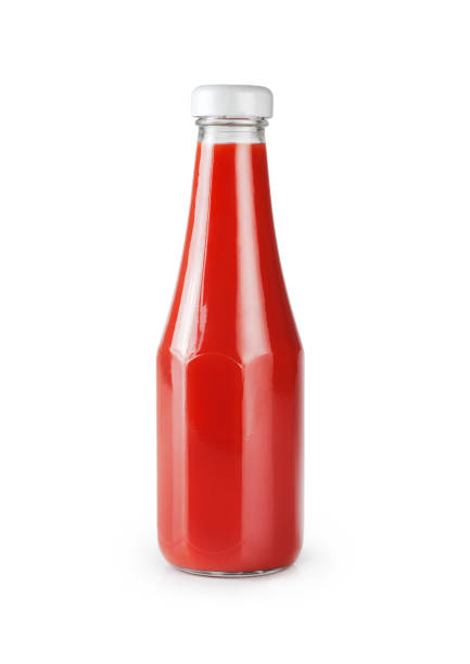 bottle with ketchup isolated on white background. - ketchup bottle stock photos and pictures