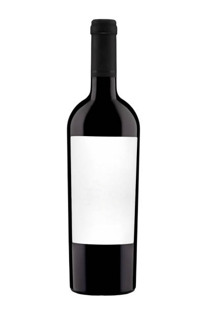 bottle with label of red wine isolated on white background. bottle with label of red wine isolated on white background. Close-up. cabernet sauvignon grape stock pictures, royalty-free photos & images