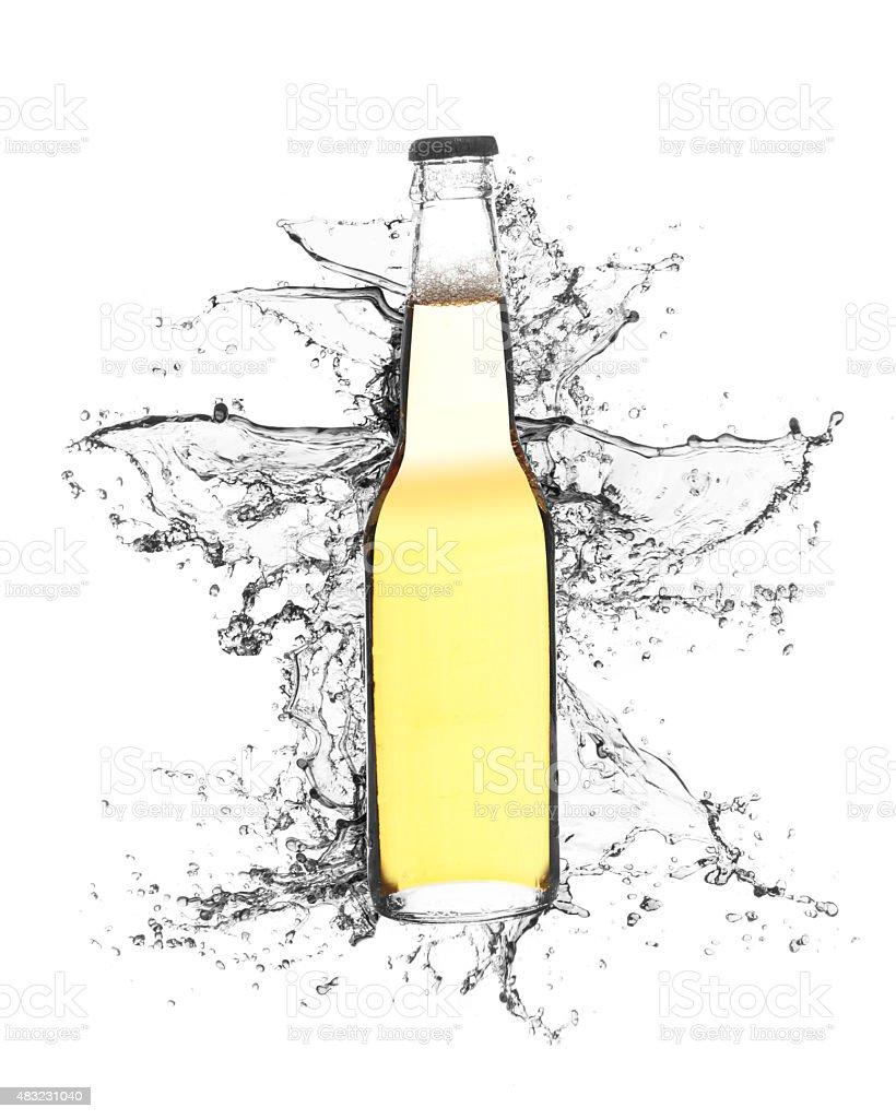 Bottle with liquid splash on white background stock photo