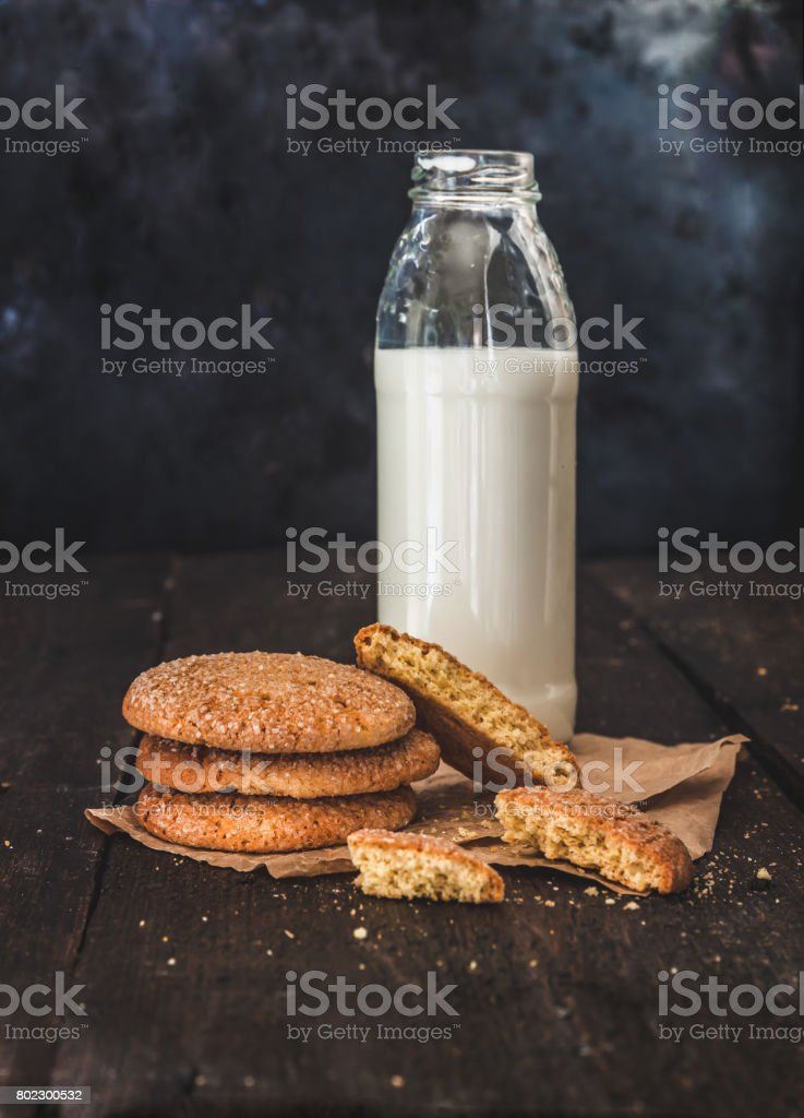 Bottle With Milk And A Stack Of Cookies On A Dark Background