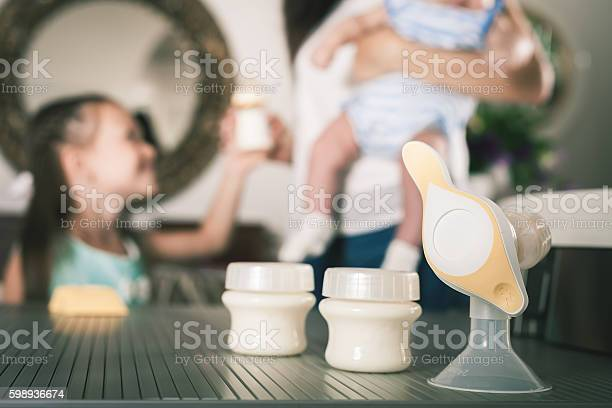 Bottle with milk and manual breast pump picture id598936674?b=1&k=6&m=598936674&s=612x612&h=hx1nuwcooi05pkzlydhdmxwoju0rzwqdfjxqhelvbwg=