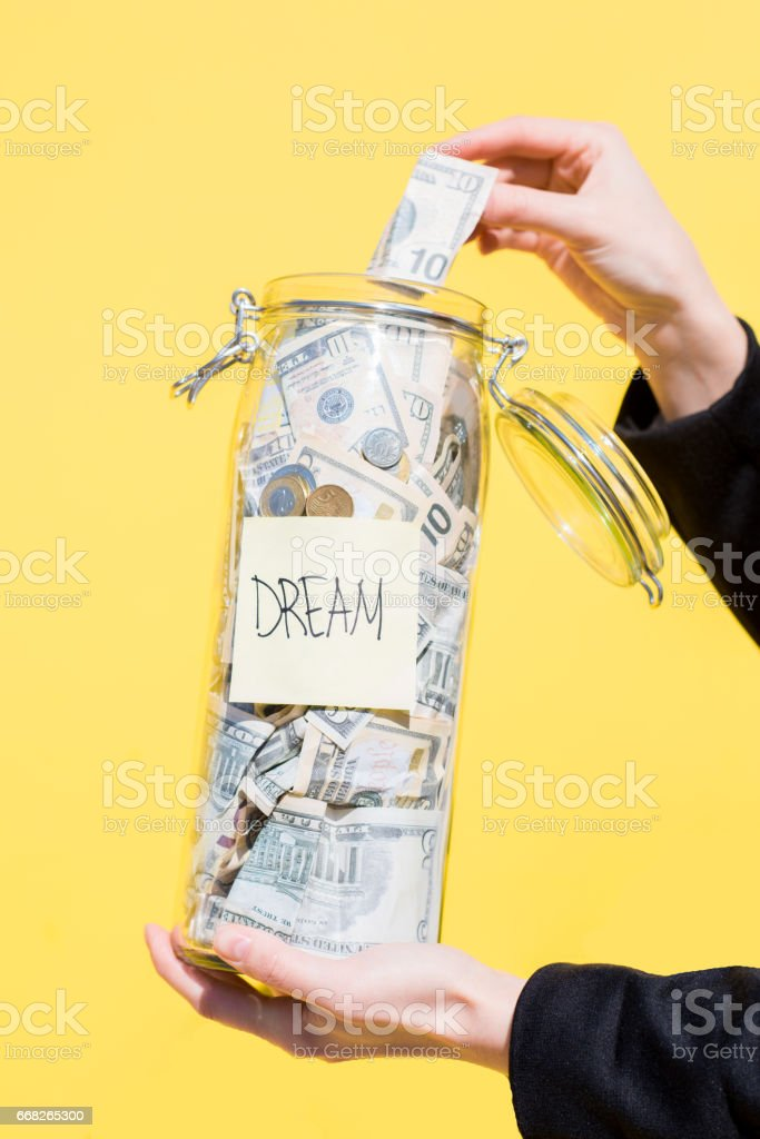 Bottle with money on the yellow background foto stock royalty-free