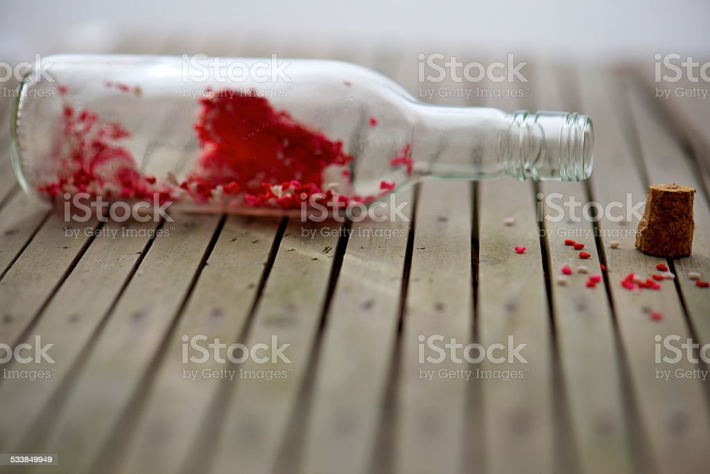 bottle with red heart inside for Valentine's message stock photo