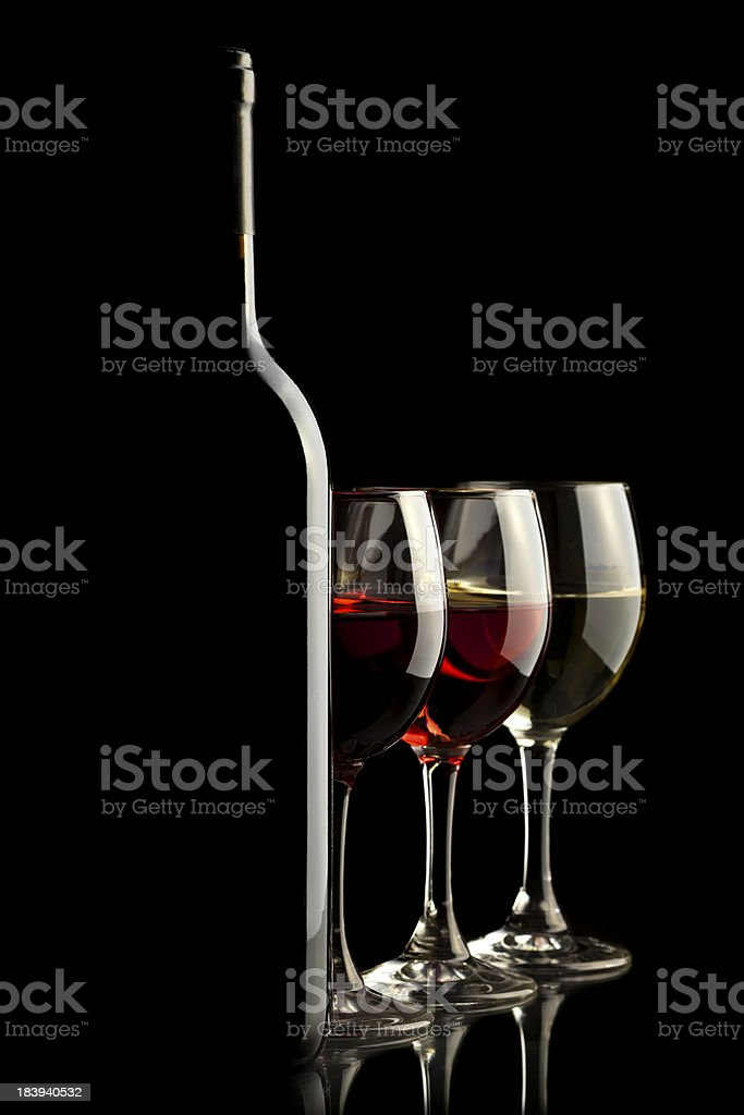 bottle with red, white and rose wine glasses royalty-free stock photo