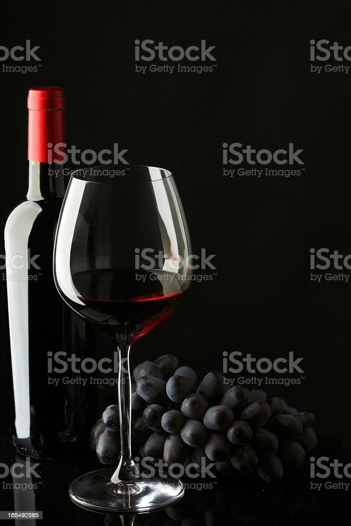 bottle with red wine glass and grapes royalty-free stock photo